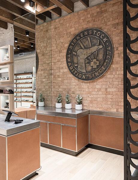 Soho Store interior wall logo